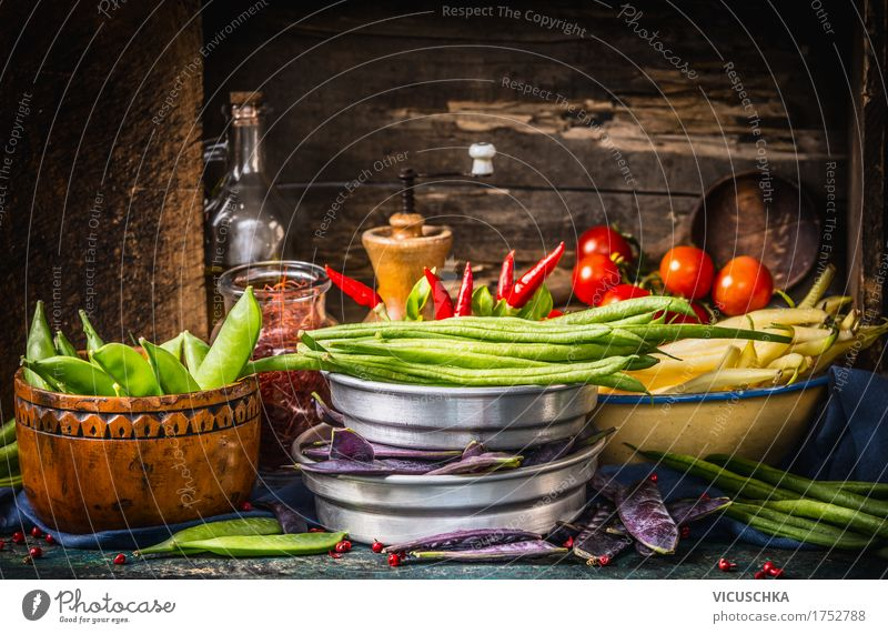 Colourful peas and beans on a rustic kitchen table Food Vegetable Herbs and spices Cooking oil Nutrition Organic produce Vegetarian diet Diet Crockery Bowl