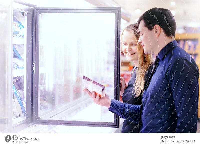 Couple in the frozen goods section Shopping Happy Human being Woman Adults Man Family & Relations Friendship 2 Smiling Frozen Checkered Supermarket Storage