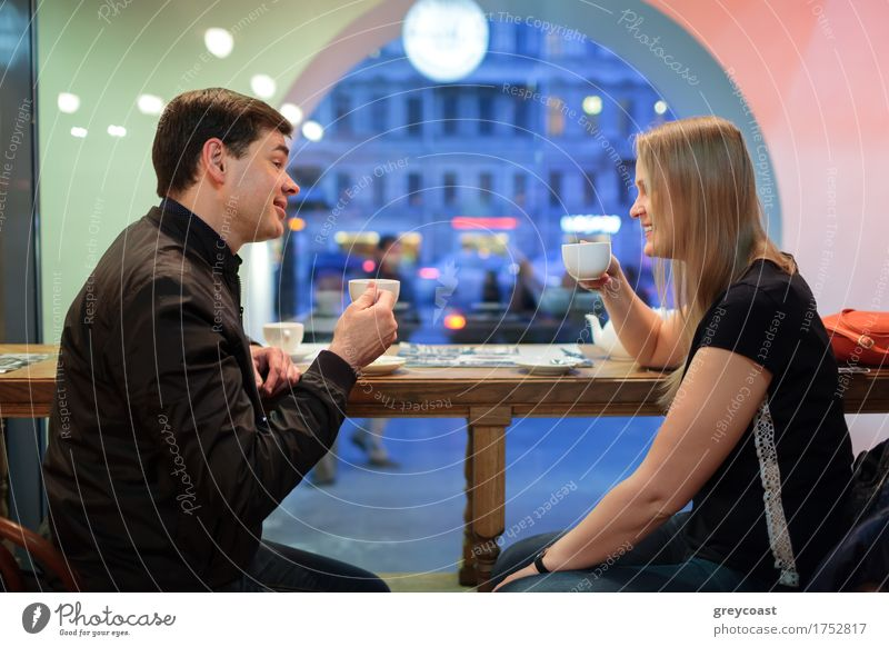 Man and woman chatting over coffee Human being Youth (Young adults) City Young woman Young man Relaxation 18 - 30 years Adults To talk Couple Friendship Blonde Friendliness Beverage Coffee Restaurant