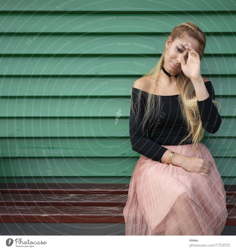 . Feminine 1 Human being Wall (barrier) Wall (building) Skirt Sweater Jewellery Hair and hairstyles Blonde Long-haired Wood Observe Relaxation Smiling Looking