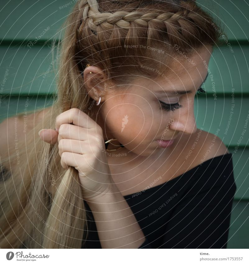 . Feminine 1 Human being Wall (barrier) Wall (building) Shirt Jewellery Piercing Earring Hair and hairstyles Blonde Long-haired Observe Think To hold on Looking