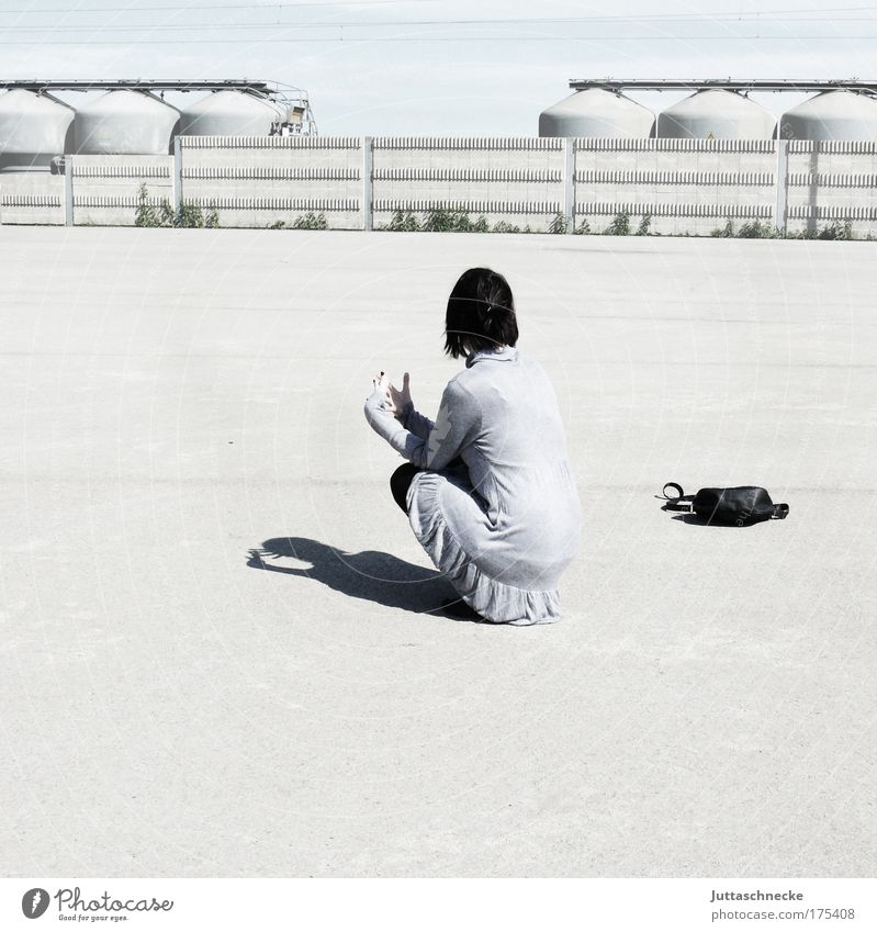 sit and wait Woman Bright Gray Sun Shadow Contrast Wait Crouch Sit Loneliness Bag Handbag Concrete Places Industrial site Back Break Calm Peace squat Dress