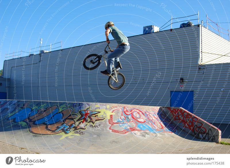 BMX jump Colour photo Exterior shot Day Worm's-eye view Wide angle Sports Cycling Bicycle BMX bike Ramp Skate park Young man Youth (Young adults) 18 - 30 years