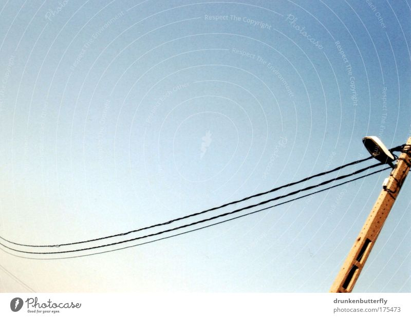 streamlines Colour photo Exterior shot Abstract Copy Space top Copy Space bottom Day Sunlight Cable Hang Electricity Lamp Street Transmission lines Sky Mast