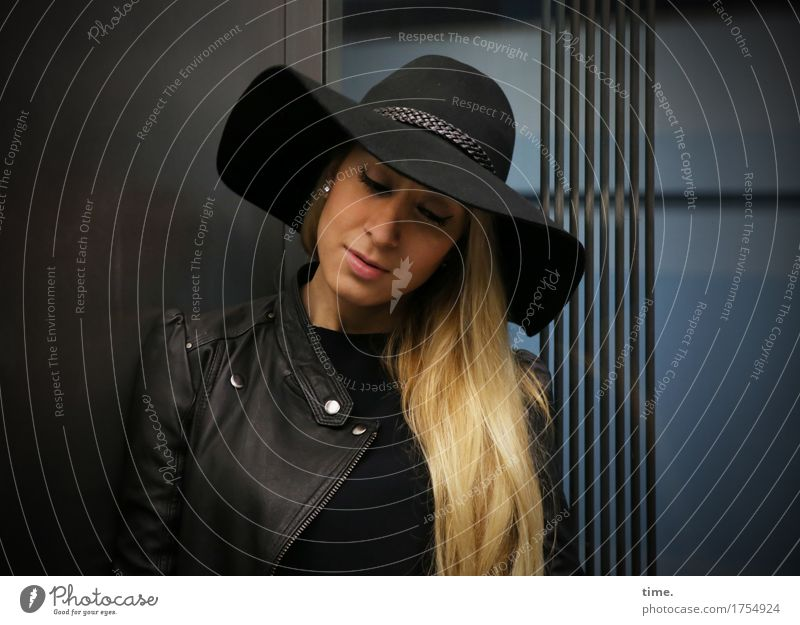 . Feminine Woman Adults 1 Human being Means of transport Elevator Jacket Hat Blonde Long-haired Observe Think Stand Wait Beautiful Self-confident Safety