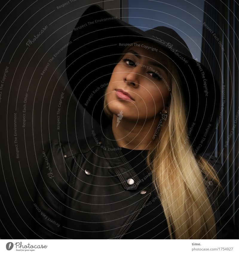 pisa Feminine 1 Human being Elevator Jacket Leather jacket Hat Blonde Long-haired Observe Think Looking Wait pretty Self-confident Cool (slang) Willpower