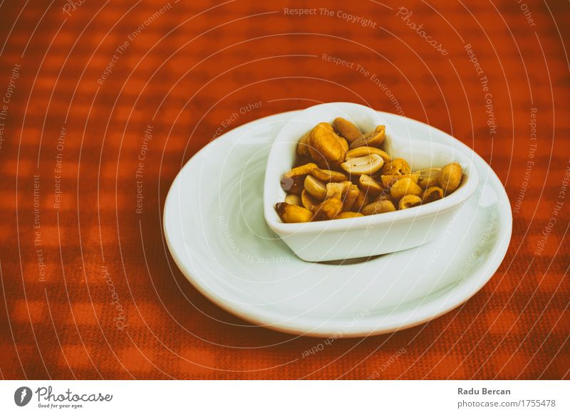 Heart Shaped Bowl With Dried Hard Fruits And Peanuts Colour White Red Eating Emotions Love Food Brown Orange Friendship Nutrition Table Simple Romance