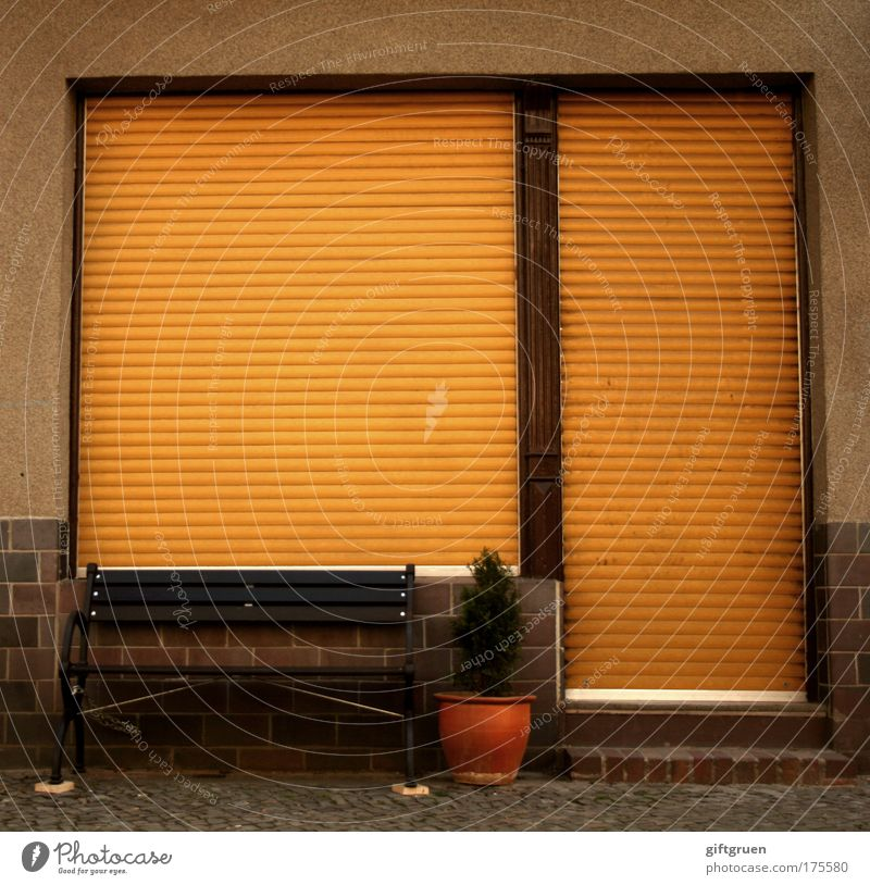 House (Residential Structure) Street Window Work and employment Door Facade Closed Wait Gloomy Break Bench Store premises Seating Flowerpot Insolvency Roller shutter