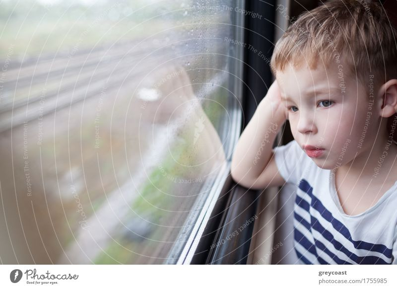 Boy looking out the window of train Human being Child Vacation & Travel Boy (child) Small Rain Weather Transport Trip Blonde Observe Railroad Drop Toddler