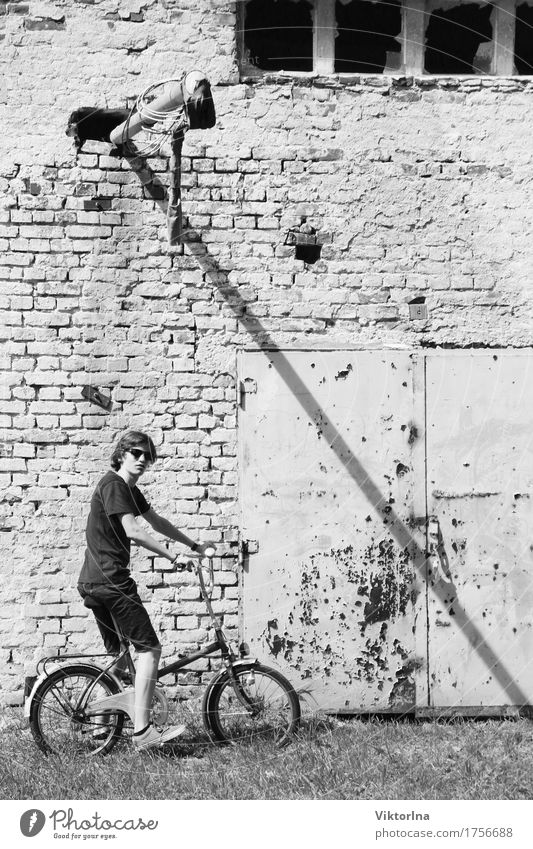 Human being Youth (Young adults) City Old Young man Dark Building Facade Metal 13 - 18 years Bicycle Poverty Cycling Transience Industry Adventure