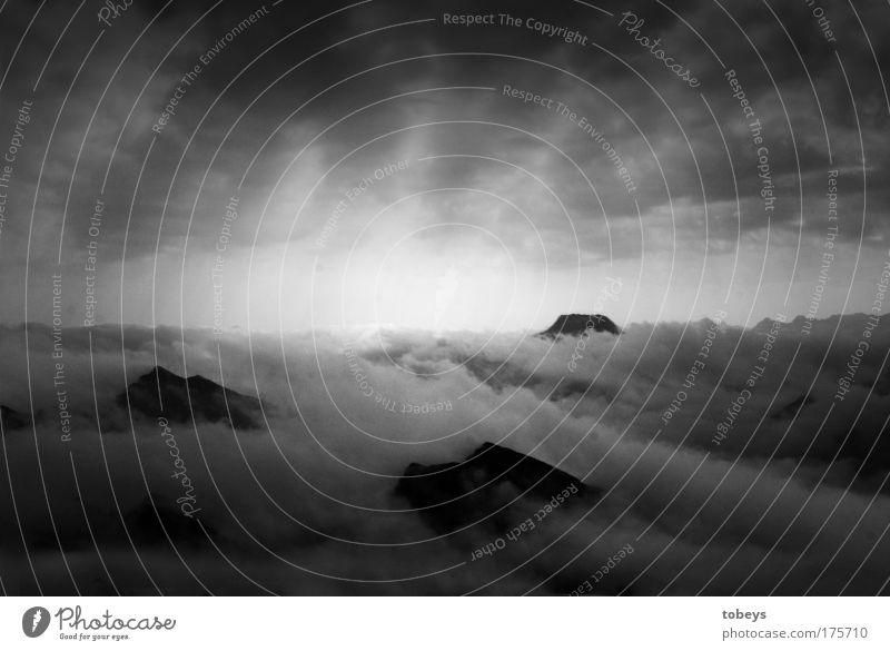 Sky Heaven Loneliness Clouds Calm Far-off places Dark Mountain Rock Horizon Leisure and hobbies Fog Tall Peak Climbing Belief