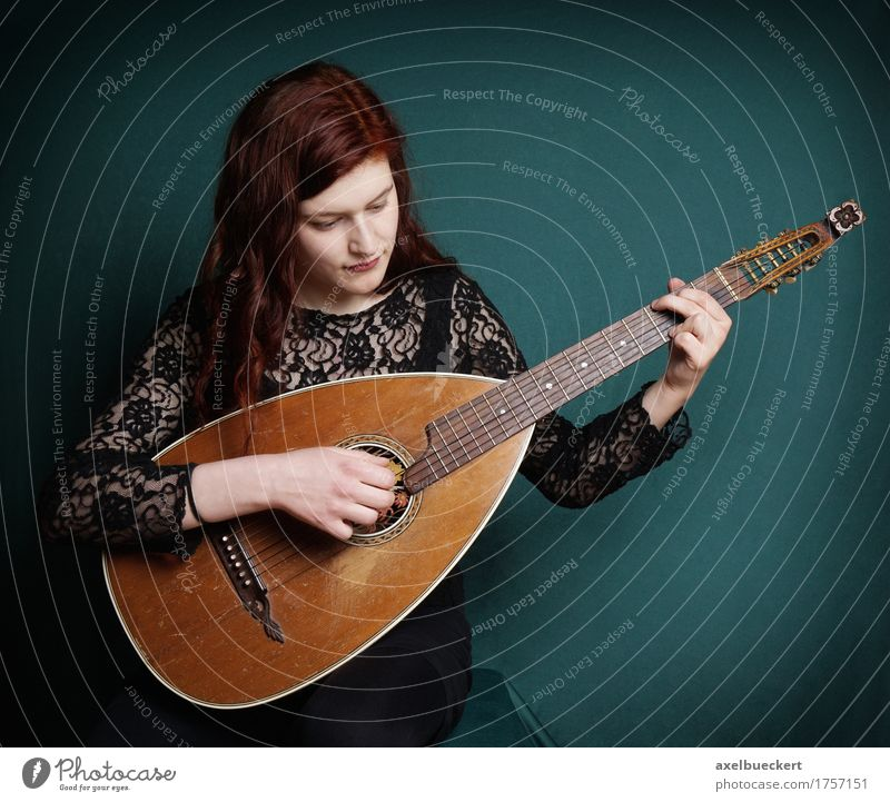 woman playing lute Lifestyle Entertainment Music Human being Feminine Young woman Youth (Young adults) Woman Adults 1 18 - 30 years Musician Guitar Make Retro