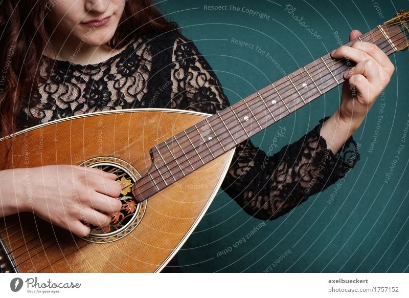 female playing lute string instrument Human being Woman Youth (Young adults) Young woman 18 - 30 years Adults Lifestyle Feminine Playing Music Retro Tradition Guitar Musical instrument Entertainment Musician