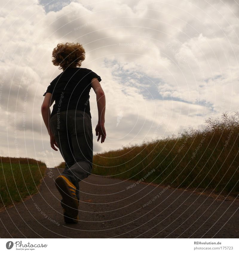 Young man running in a street Colour photo Exterior shot Copy Space right Day Contrast Silhouette Full-length Looking away Human being Masculine