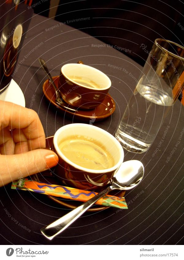 Time for an Espresso II. Hand Fingers Cup Spoon Sugar Table Drinking Hot Nutrition Glass Water Mineral water Coffee