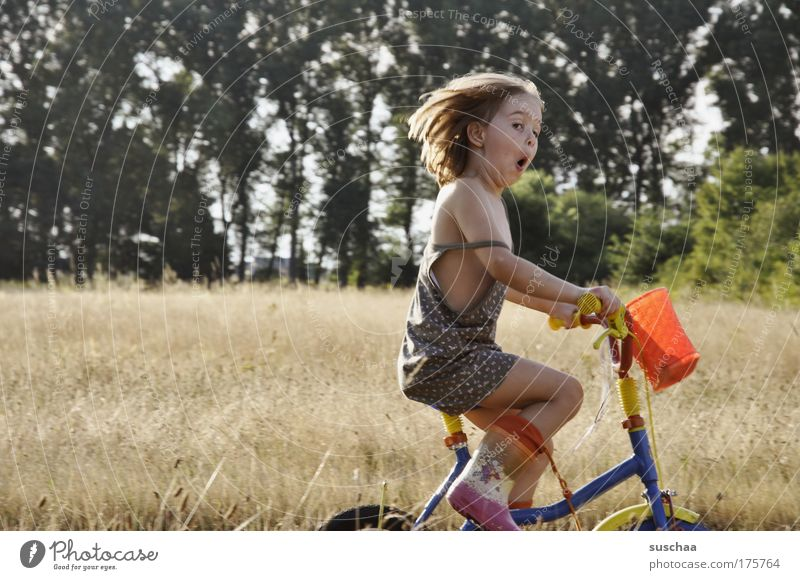 Human being Child Youth (Young adults) Leisure and hobbies Driving Girl Joy Playing Movement Happy Funny Infancy Bicycle Wild Natural Free
