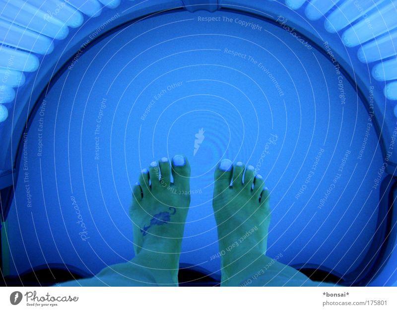 solarium Beautiful Skin Wellness Well-being Sunbathing Feminine Woman Adults Legs Feet 1 Human being Illuminate Lie Esthetic Bright Blue Colour photo