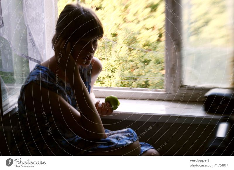 >8<<< Human being Youth (Young adults) Blue Green Window Feminine Young woman Think Moody Flat (apartment) Fruit Food Dress Apple Listening Serene