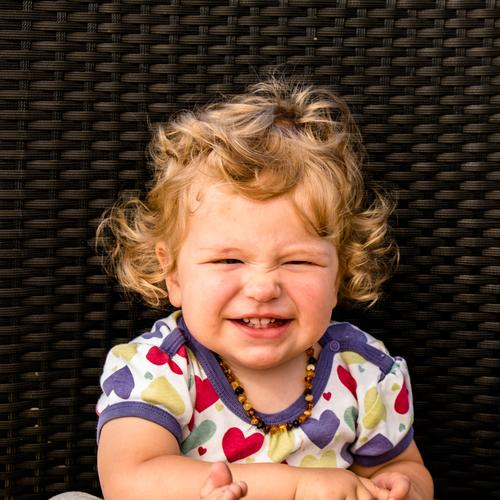 Girl pulls nose curly Human being Feminine Child Toddler Sister Infancy Life Head 1 1 - 3 years Hair and hairstyles Brunette Blonde Curl Laughter Happy