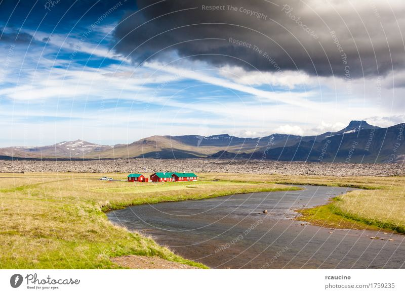 Red houses next a river in icelandic countryside Sky Nature Vacation & Travel Blue Summer Green Sun Landscape Red House (Residential Structure) Mountain Building Group Tourism Europe Hill