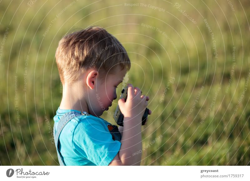 Little boy with camera outdoor Summer Child Camera Boy (child) Infancy 1 Human being 1 - 3 years Toddler Nature Landscape Park Forest Blonde Small Retro Brave