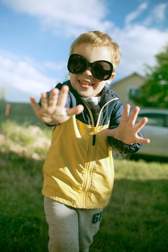 Happy little boy having fun in big sunglasses outdoor Joy Summer Child Boy (child) Infancy 1 Human being 3 - 8 years Nature Landscape Sunglasses Blonde Smiling