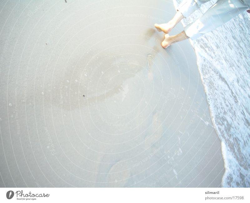 Man Ocean Beach Feet Sand Legs Waves Hiking Going Walking Wet To go for a walk Pants Footprint