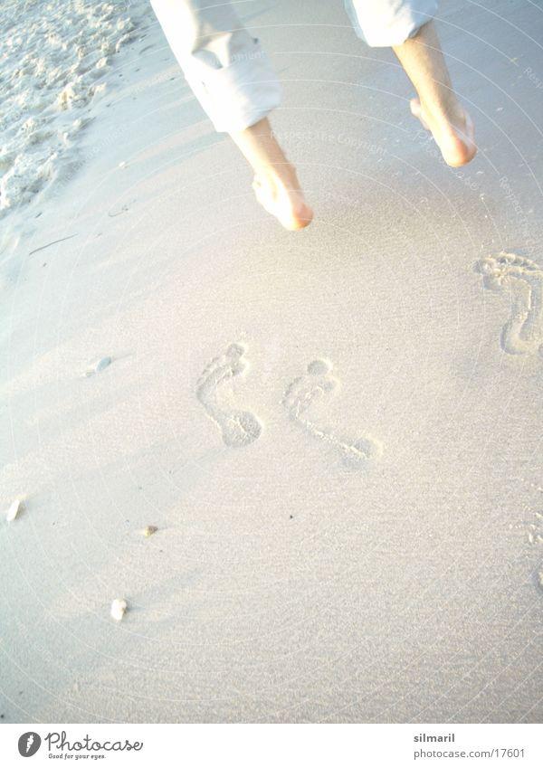 Beach Series V Hop Jump Happiness Exuberance Man Ocean Waves Reflection Going To go for a walk Hiking Pants Wet Footprint White crest Pebble Break Summer