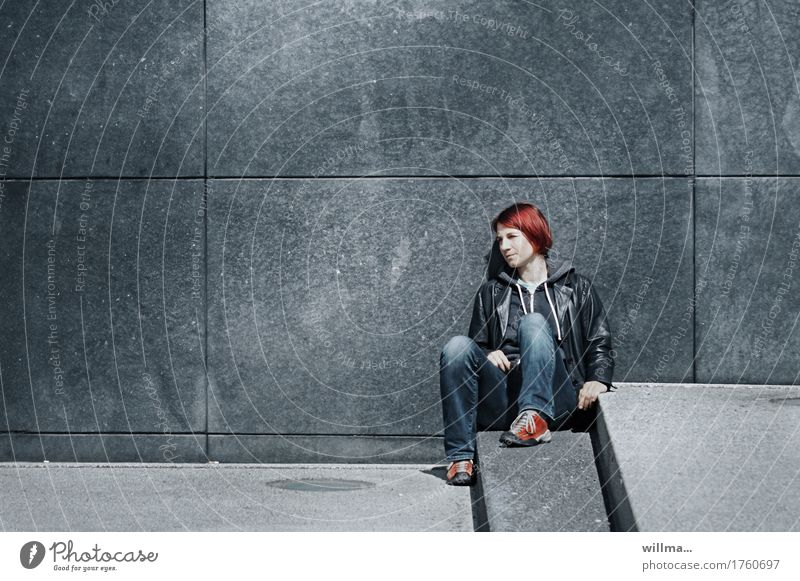 Young casual woman in leather jacket and jeans takes a little time out sitting on steps Youth (Young adults) Young woman Sit stagger Leather Red-haired Observe