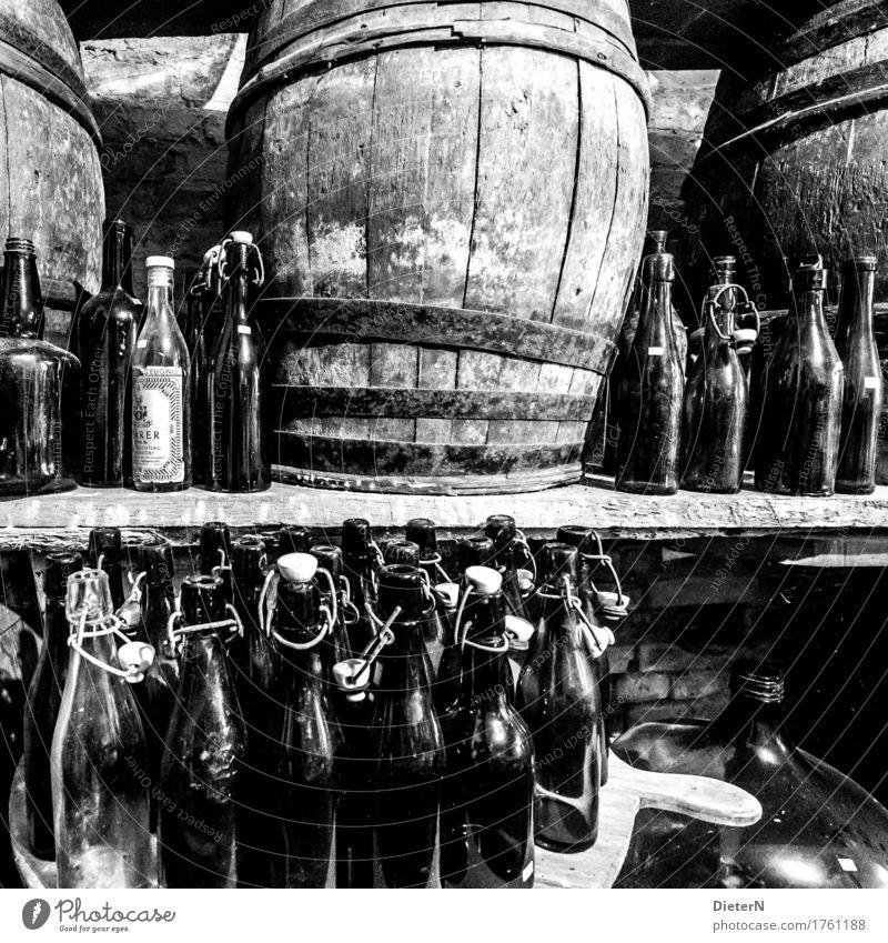 bottle deposit Wood Glass Gray Black White Keg Bottle Old Cellar arch Wine cask Bottle of beer Shelves wooden barrel Derelict Black & white photo Interior shot