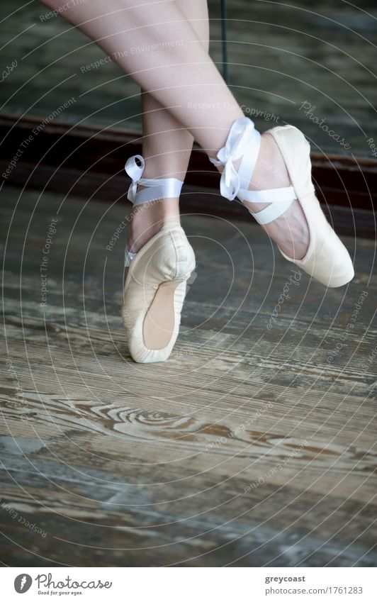 Close-up shot of female feet in ballet shoes dancing on the wooden floor Elegant Beautiful Dance Academic studies Girl Youth (Young adults) Feet 1 Human being