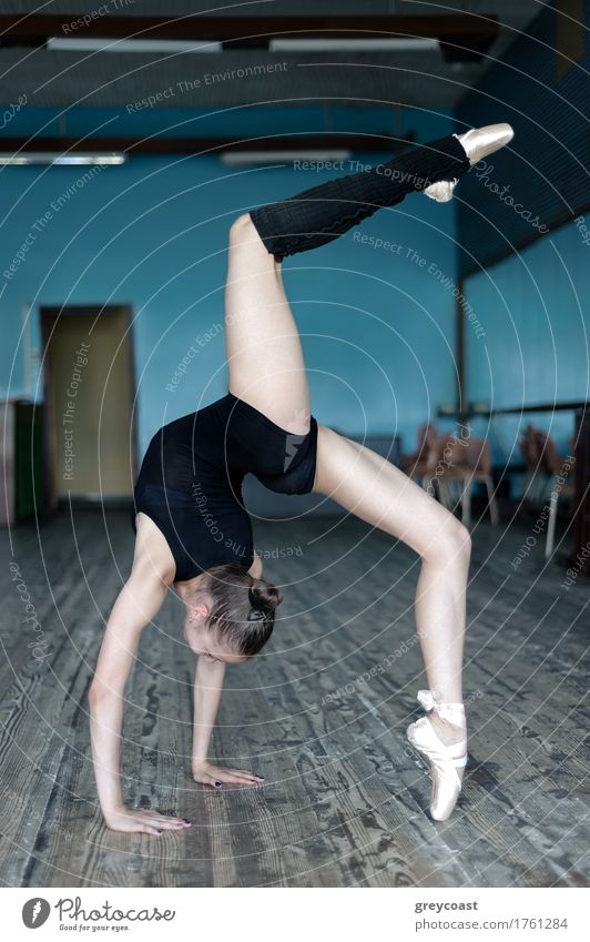 Young ballet dancer practising in the studio Human being Youth (Young adults) Hand Girl School 13 - 18 years Stand Dance Academic studies Railroad Thin Brunette