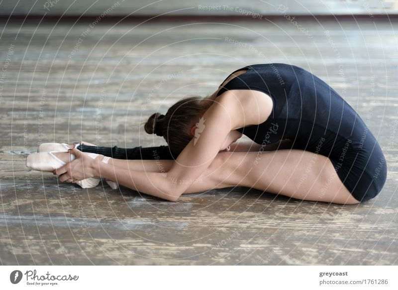 Ballet dancer stretching out sitting on the floor Human being Youth (Young adults) Girl Wood School 13 - 18 years Sit Happiness Dance Academic studies Railroad