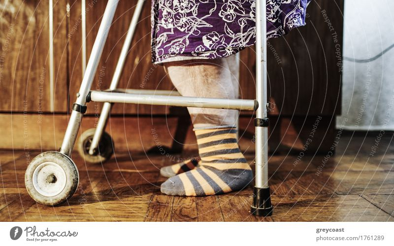 Elderly woman going slowly with the help of walker Female senior Woman Feet 1 Human being 60 years and older Senior citizen Old Loneliness Effort aid step