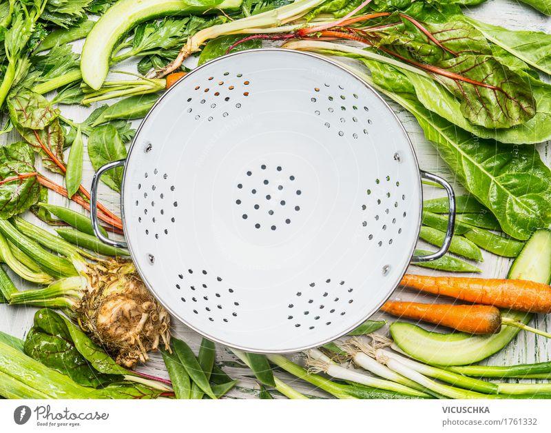 Green organic vegetables around empty kitchen sieve Food Vegetable Nutrition Organic produce Vegetarian diet Diet Crockery Style Design Healthy Healthy Eating