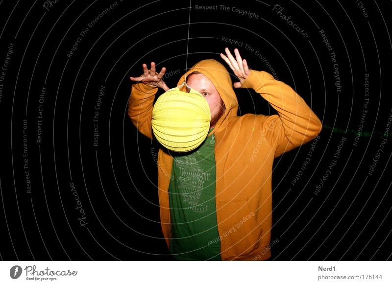 magic Yellow Magic Hover Night Black Green Man Funny Looking Hand Young man Adults Magician Isolated Image Dark background Copy Space left Concentrate Flying