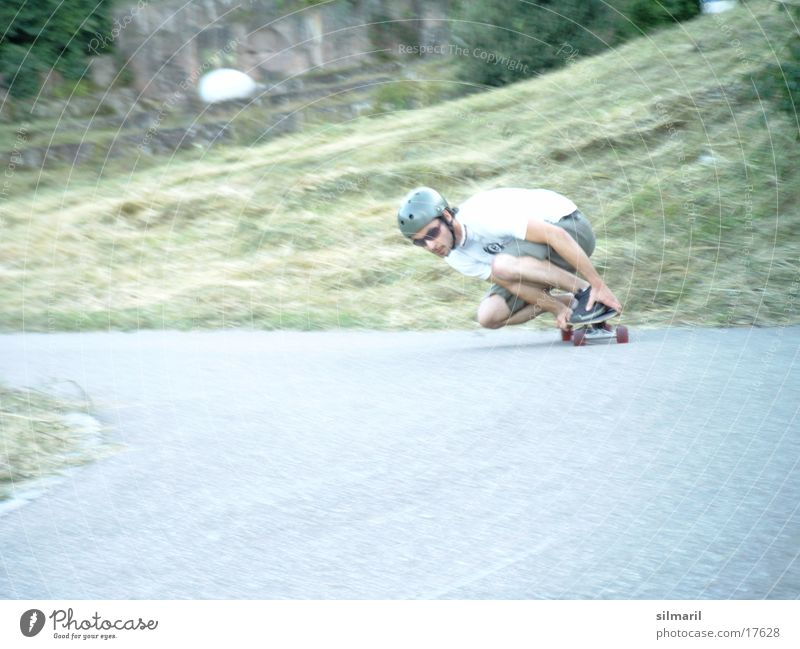 In action II Leisure and hobbies Sports Jeans Helmet Cool (slang) Speed Skateboarding Action Asphalt longboard fun Coil Colour photo