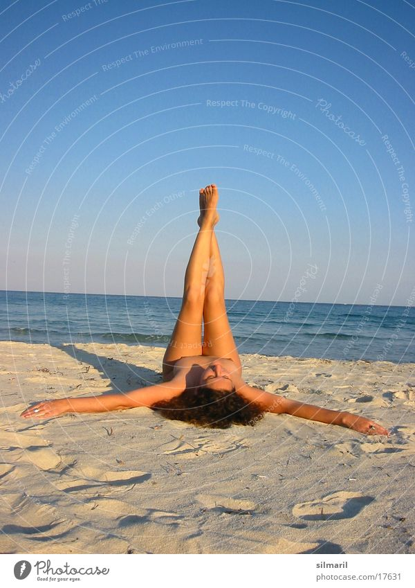 Up your legs I Relaxation Leisure and hobbies Vacation & Travel Beach Ocean Woman Adults Legs Sand Water Fitness Lie Gymnastics Colour photo