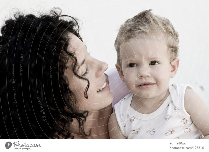 motherly love Colour photo Interior shot Copy Space left Copy Space right Copy Space top Copy Space bottom Neutral Background Day portrait Downward Looking away