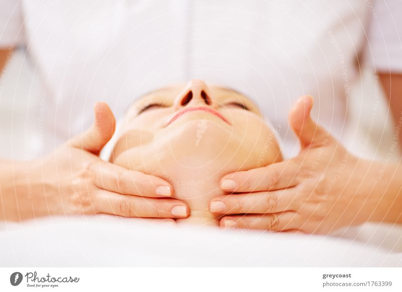 Close-up shot of woman on seance of facial massage with accent on chin Skin Face Health care Medical treatment Relaxation Spa Massage Doctor Woman Adults Hand 2