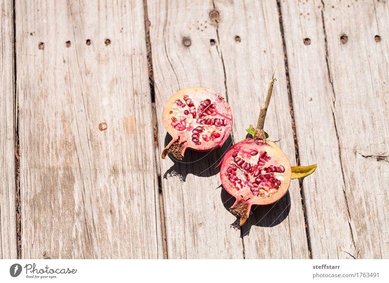 pomegranate fruit Punica granatum Food Fruit Nutrition Breakfast Organic produce Vegetarian diet Diet Skin Healthy Plant Leaf Wood Brown Pink Red Desire Lust