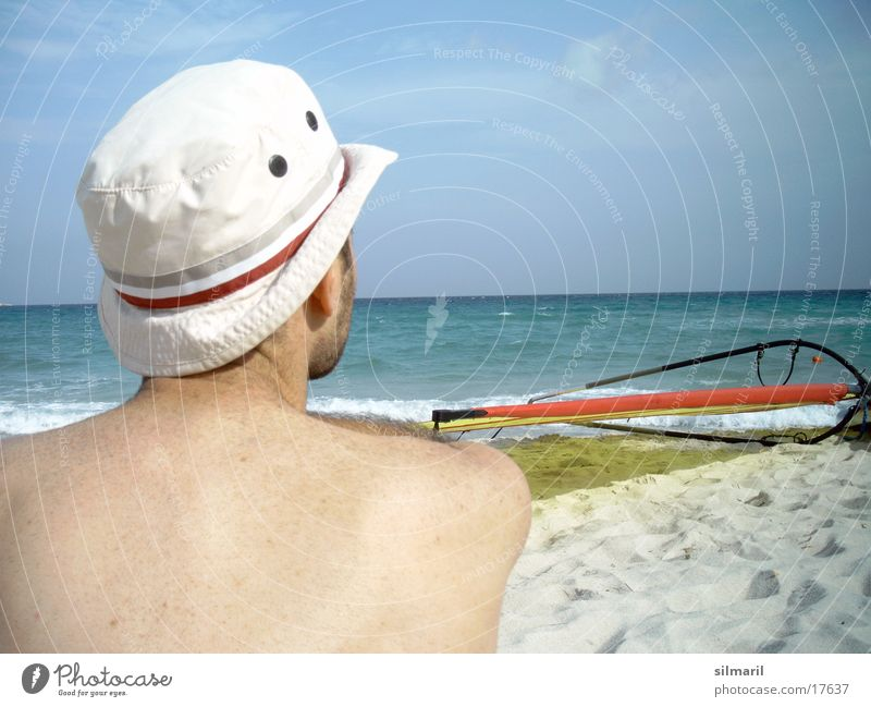 Still wind I Beach Ocean Man Leisure and hobbies Vacation & Travel Horizon Surfboard Cap Thought Think Water Sand Relaxation Sky Hat Back Sit