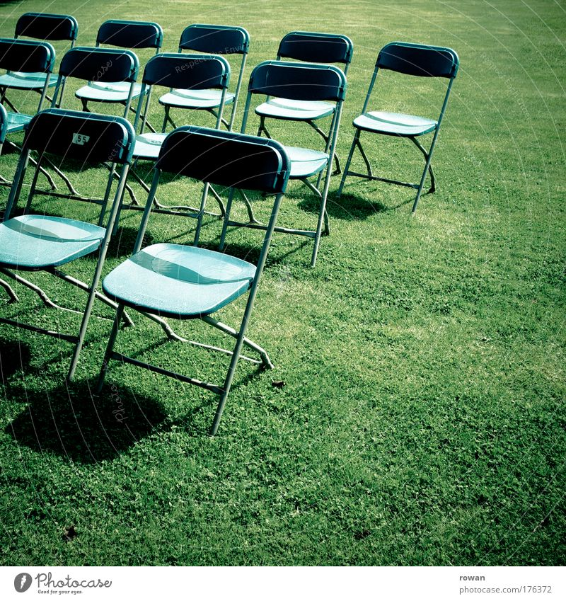 empty rows Colour photo Exterior shot Copy Space right Copy Space bottom Day Event Stage Blue Green Empty Chair Seat Audience Folding chair Presentation Shows