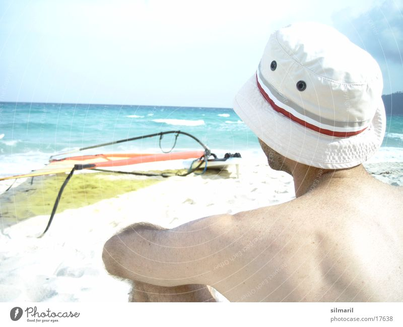 Still wind II Beach Ocean Man Leisure and hobbies Vacation & Travel Horizon Surfboard Cap Thought Think Water Sand Relaxation Sky Hat Back Sit