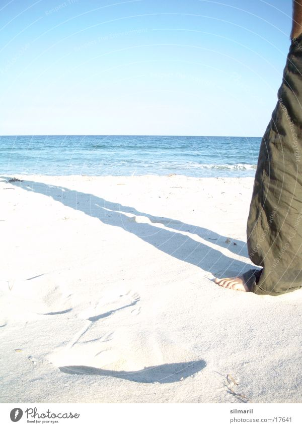 Lonesome on the beach II Beach Ocean Man Leisure and hobbies Vacation & Travel Relaxation Cure Health resort Horizon Stand Pants Stay Calm Far-off places Think