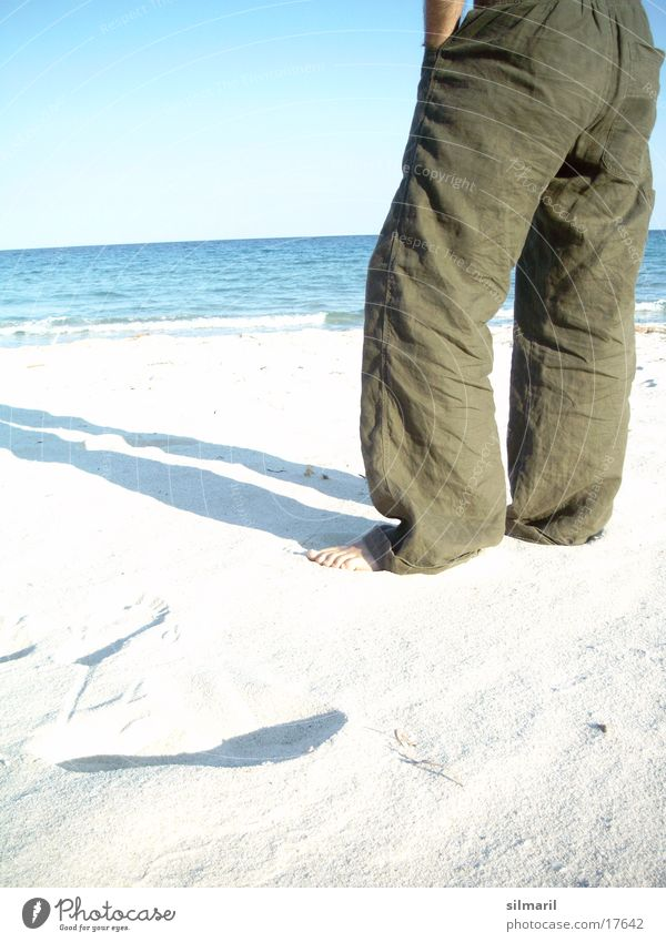 Lonesome on the beach I Beach Ocean Man Leisure and hobbies Vacation & Travel Relaxation Cure Health resort Horizon Stand Pants Stay Calm Far-off places Think