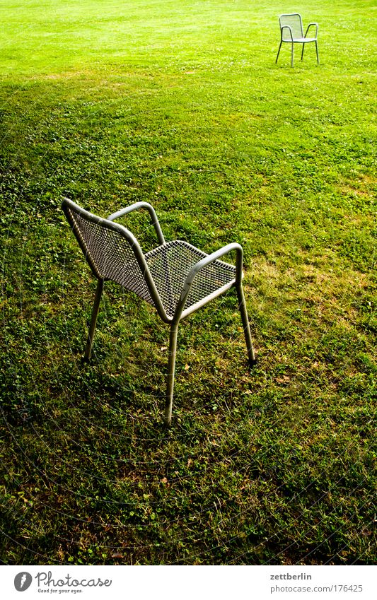 Two more chairs Green Lawn Grass surface Meadow Park Chair Garden chair Outdoor furniture Meeting Date Comparison Communicate Dialog partner Opposite Places