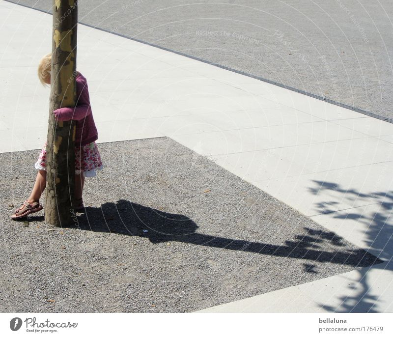 ... everything must be hidden!!! Human being Girl Infancy 1 To enjoy Walking Tree Hide Hiding place Colour photo Exterior shot Day Shadow Sunlight Asphalt