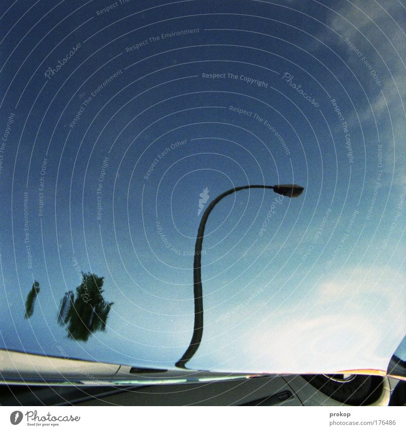 Trick Seventeen Colour photo Exterior shot Copy Space top Reflection Central perspective Street Lamp Lantern Sky Beautiful weather Car Surrealism Distorted Tire