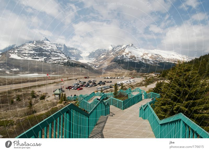 Icefield Center Colour photo Exterior shot Day Sunlight Vacation & Travel Tourism Far-off places Summer Air Sky Clouds Mountain Rocky Mountains Icefield parkway